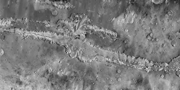 A close up of the full length of Valles Marineris, a 'Grand Canyon' of Mars and the largest canyon system in the solar system, which is nearly 2,500 miles (4,000 kilometers) long.
