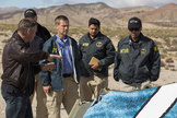 Virgin Galactic pilot Todd Ericson shares information at the SpaceShipTwo accident site with National Transportation Safety Board (NTSB) officials. The first SpaceShipTwo broke apart and crashed during rocket-powered test flight over the Mojave Desert in California on Oct. 31, 2014, killing one pilot and injuring another.