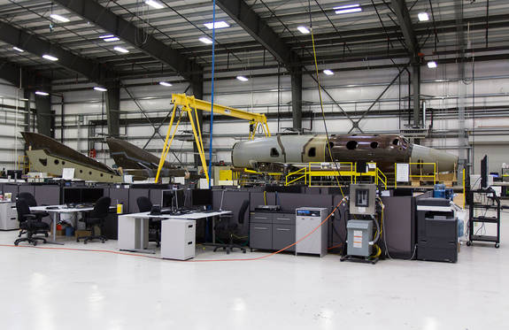 Virgin Galactic's second SpaceShipTwo suborbital spacecraft is seen under construction. Virgin Galactic plans to use SpaceShipTwo to launch two pilots and six passengers on suborbital spaceflights. Tickets are available for $250,000 per seat.