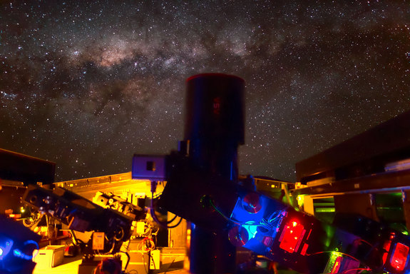 This night view shows the Next-Generation Transit Survey (NGTS) telescopes during testing. The central parts of the Milky Way appear in the background.