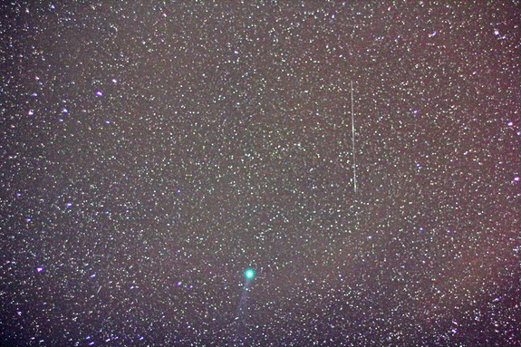 A ring of green light encircles Comet Lovejoy, in this image captured on Jan. 9, 2015, in Jadwin, Missouri. Amateur astronomer Victor Rogus used a 50mm manual focus Zeiss lens for a 36-second exposure.