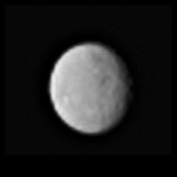 A zoomed-in view of the dwarf planet Ceres, seen from a distance of 238,000 miles (383,000 kilometers) by the Dawn spacecraft on Jan. 13, 2015. The image hints at the presence of craters and other features on Ceres' surface.