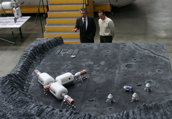 Space entrepreneur, Robert Bigelow (left) explains company's plans for commercial operations on the moon.