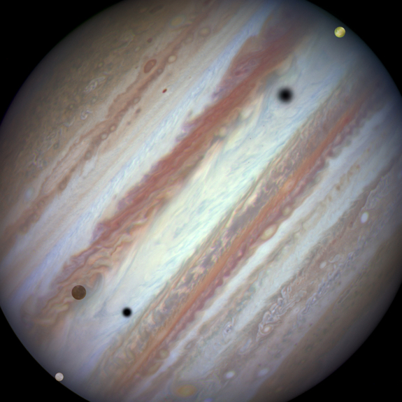 Three moons and their shadows move across Jupiter during a rare triple transit on Jan. 24, 2015. Europa is at lower left, Callisto is above and to the right of Europa and Io is approaching Jupiter's eastern limb. Europa's shadow is toward the left side of the image and Callisto's shadow to the right.