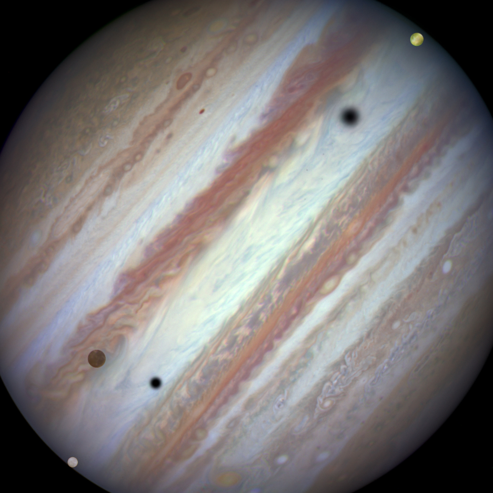 Three moons and their shadows move across Jupiter during a rare triple transit on Jan. 24, 2015. Europa is at lower left, Callisto is above and to the right of Europa and Io is approaching Jupiter's eastern limb. Europa's shadow is toward the left side of