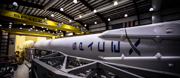 A SpaceX Falcon 9 rocket equipped with landing legs is seen in this image from the private spaceflight company's website. SpaceX will attempt to land the first stage of its Falcon 9 rocket on an ocean platform on Feb. 8, 2015 after launching the Deep Space Climate Observatory, a space weather satellite, for NASA and NOAA.