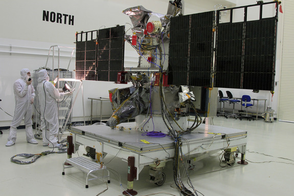 Engineers test the solar arrays on the NOAA/NASA Deep Space Climate Observatory, a satellite designed to serve as an early warning system for solar storms launching in February 2015.