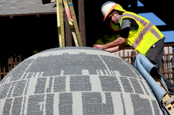 "A worker at LEGOLAND California puts together the ""Star Wars"" Miniland Death Star before the opening on March 5, 2015."