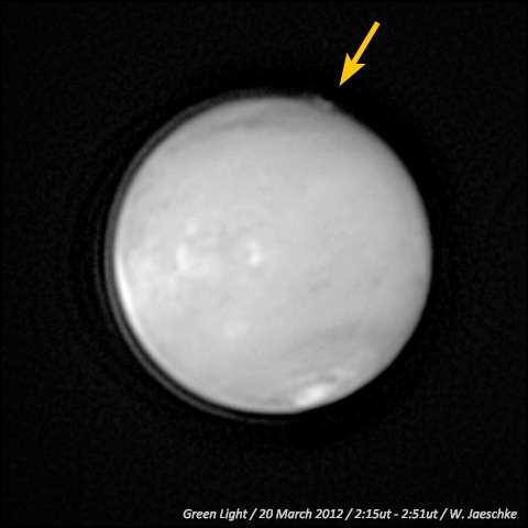Caption: An image captured by amateur astronomer W. Jaeschke in 2012 revealed a mysterious plumelike feature (marked with yellow arrow) at the limb of the Red Planet. The image is shown with the North Pole toward the bottom and the South Pole to the top.