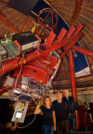 Frank Drake, center, with his colleagues, Optical SETI (OSETI) Principal Investigator Shelley Wright and Rem Stone with the 40-inch Nickel telescope at Lick Observatory in California. Outfitted with the OSETI instrument, the silver rectangular instrument package protrudes from the bottom of the telescope, plus computers, etc.