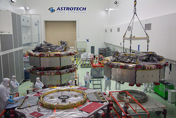 All four MMS satellites, shown here in a clean room at Astrotech. The four satellites will fly in a pyramid formation to give scientists a three-dimensional view of magnetic reconnection — the driver of solar weather.