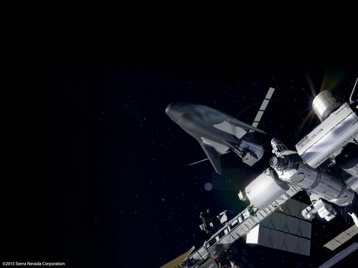 Artist's concept showing Sierra Nevada's unmanned Dream Chaser Cargo System docking to the International Space Station.