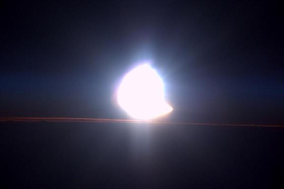NASA astronaut Terry Virts took this image of a solar eclipse on March 20, 2015. The moon appears to take a bite out of the sun as it comes above the horizon.