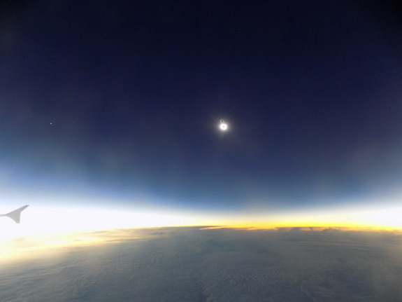 The total solar eclipse of March 20, 2015 reaches its maximum phase, or totality, as seen from an eclipse-chasing jet over the North Atlantic Ocean.