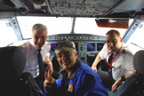 Space.com skywatching columnist Joe Rao poses with Capt. Joe Heinz and First Officer Dirk Pleimling in the cockpit of an eclipse-chasing jet chartered by AirEvents/Deutsche Polarflug and Eclipse-Reisen to follow the 2015 total solar eclipse over the North Atlantic Ocean on March 20, 2015.