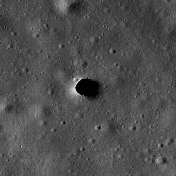 Skylights on the Moon are collapses that occur over subsurface voids. Skylights occur in many terrestrial lava tubes, providing access, although sometimes requiring shimming down a rope. If the skylight roof is too thin, their edges may collapse, making them dangerous places to stand. Shown here is a skylight in the Moon's Marius Hills.