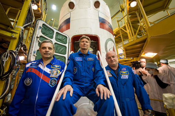 NASA's Scott Kelly (right) and cosmonaut Mikhail Kornienko (left) will fly to the International Space Station for a yearlong stay in space on March 27, 2015. Cosmonaut Gennady Padalka (center) will join them on the station for about six months.
