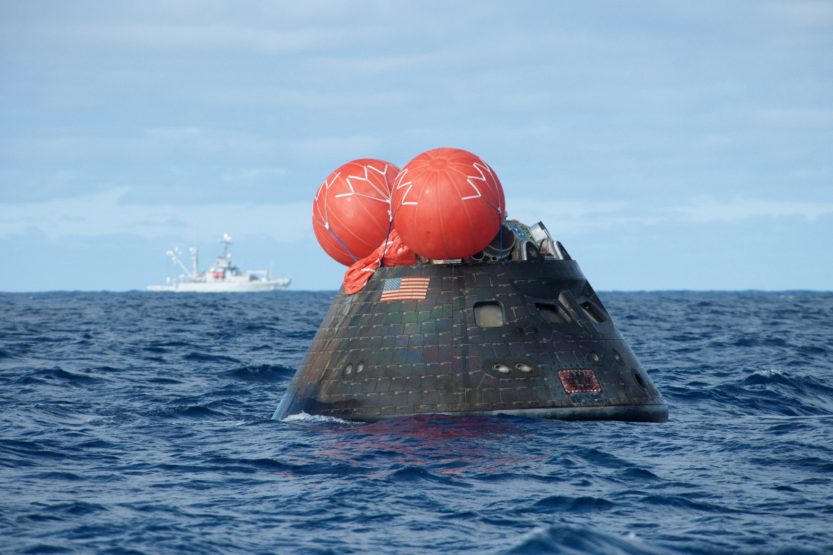 NASA's Orion spacecraft floats in the Pacific Ocean after its first test flight, known as Exploration Flight Test-1 (EFT-1), on Dec. 5, 2014.