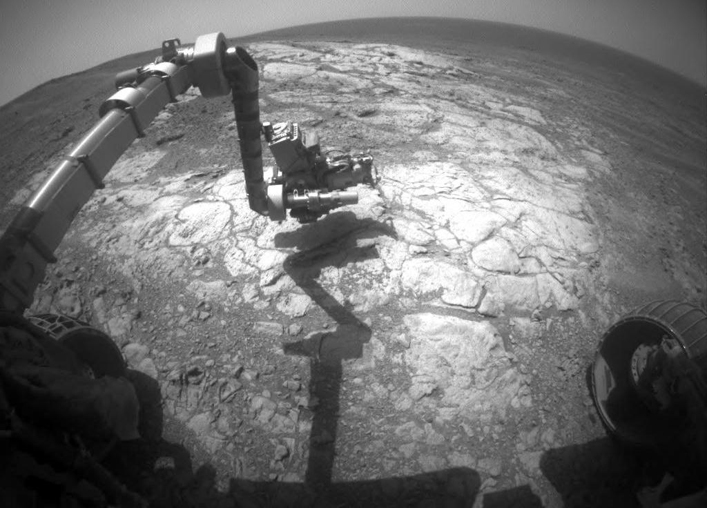 "NASA's Opportunity Mars rover examines a rock dubbed ""Athens"" in this image taken on March 25, 2015, by the rover's front hazard avoidance camera."