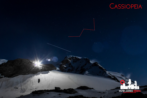 The big W of Cassiopeia, marked in red, shines bright over an alpine hut, high in the Italian mountains, with the International Space Station (seen as a light streak) making a flyby.