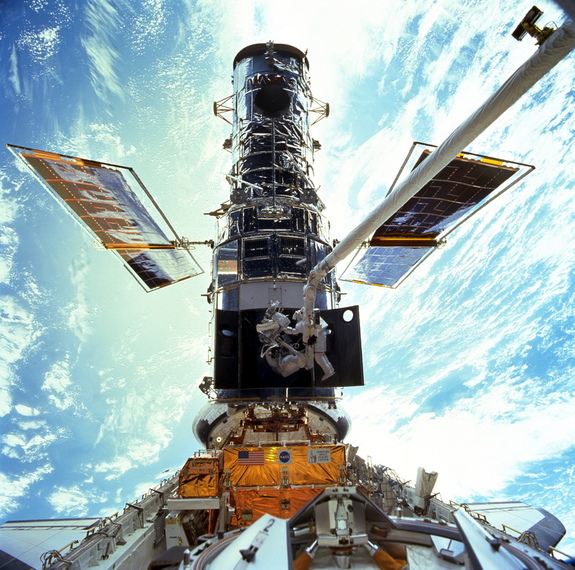 The Hubble Space Telescope gets an upgrade from NASA astronauts John Grunsfeld and Steven during the STS-103 servicing mission to the observatory in December 1999. There have been 5 manned missions to repair and upgrade Hubble.