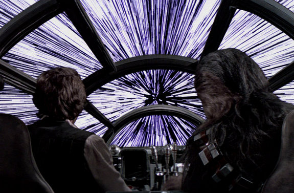 """The Millennium Falcon spaceship makes the """"jump to light speed"""" in the movie Star Wars Episode IV: A New Hope."""