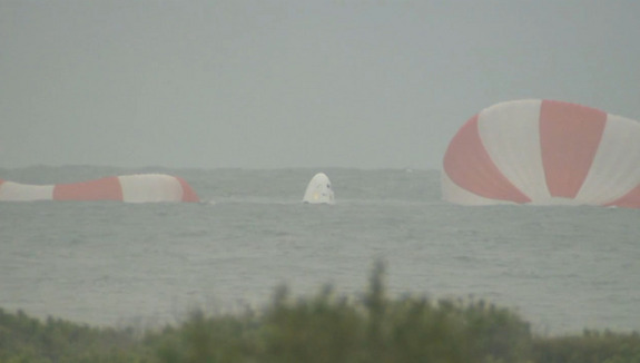 SpaceX's first Dragon crew capsule floats in the Atlantic Ocean, its parachutes nearby, after an unmanned launch abort system test from nearby Cape Canaveral Air Force Station in Florida on May 6, 2015.