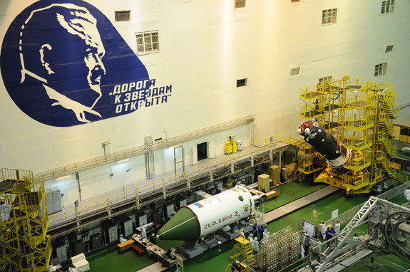 Russia's unmanned Progress 59 cargo ship prepared to be loaded inside its protective fairing ahead of its April 28, 2015 launch atop a Soyuz rocket.