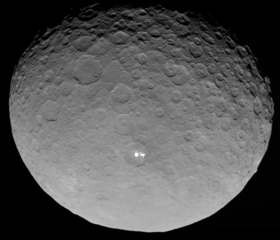 NASA's Dawn spacecraft captured this image of the dwarf planet Ceres and its mysterious bright spots on May 4, 2015, from a distance of 8,400 miles (13,500 kilometers).