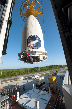 Encapsulated in its fairing, the United States Air Force's X-37B space plane is positioned for attachment to its Atlas V booster.