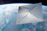 An artist's illustration of the Planetary Society's LightSail solar sail cubesat in orbit.