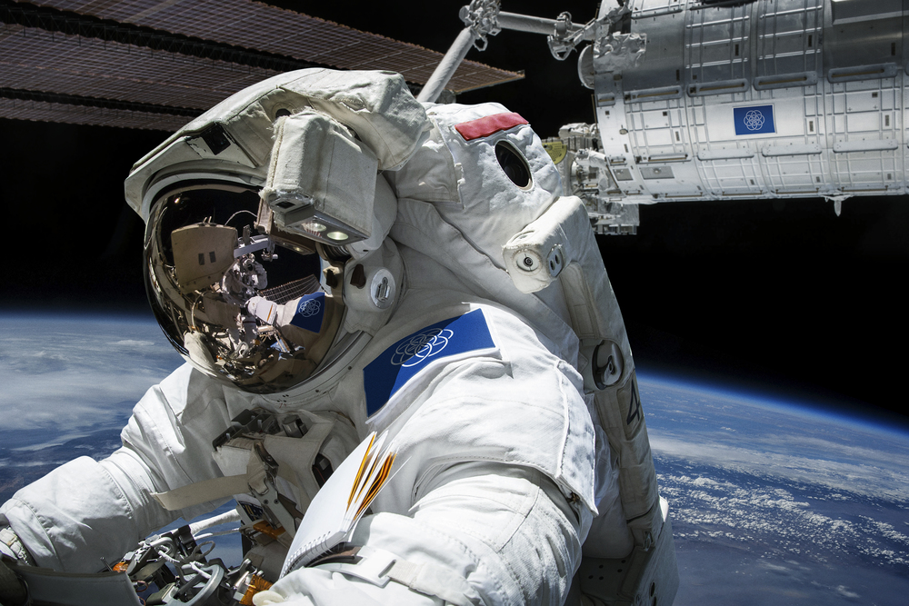 Astronaut Wearing the Proposed International Flag of Planet Earth