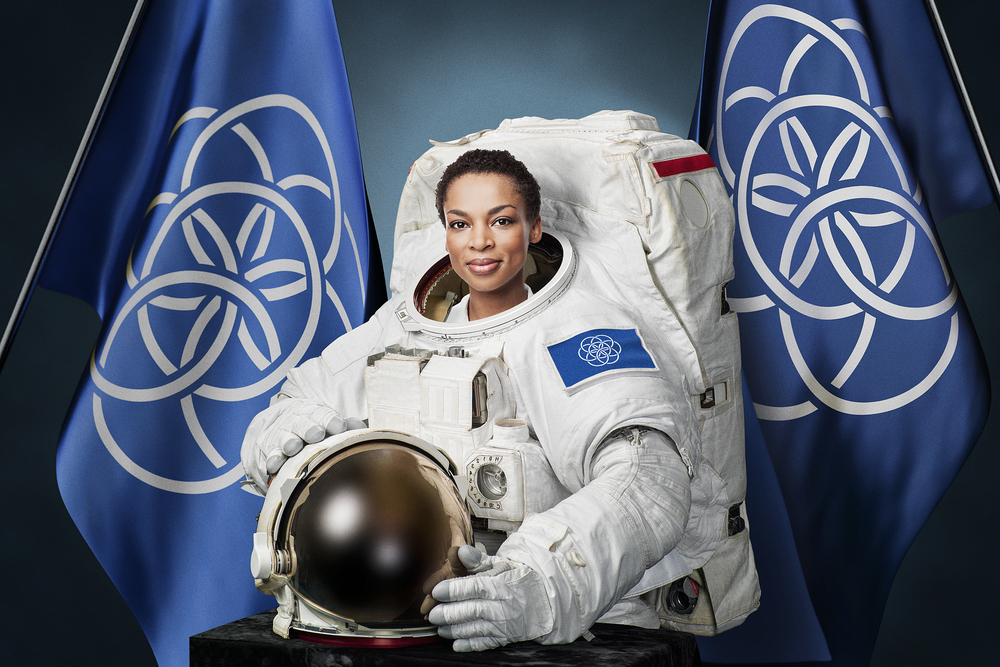 Astronaut Posing with Proposed International Flag of Planet Earth