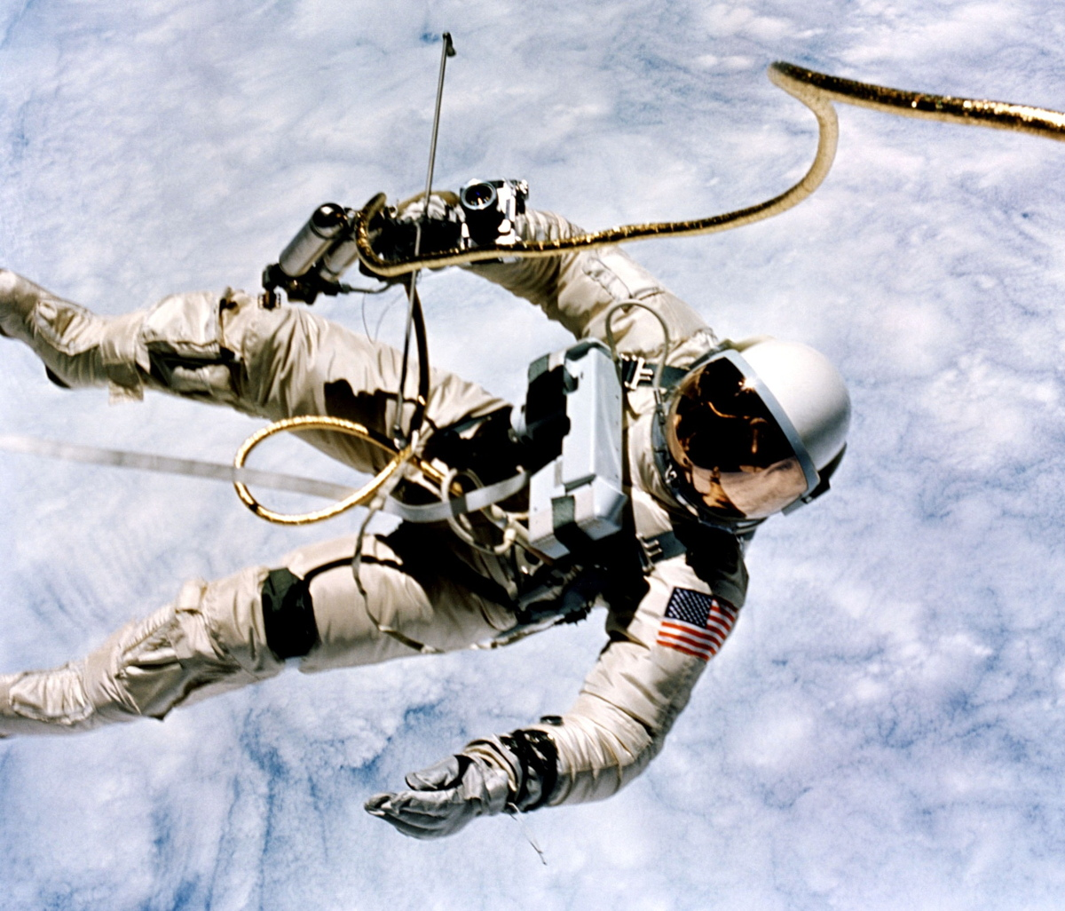 Ed White Spacewalks with Clouds in Background