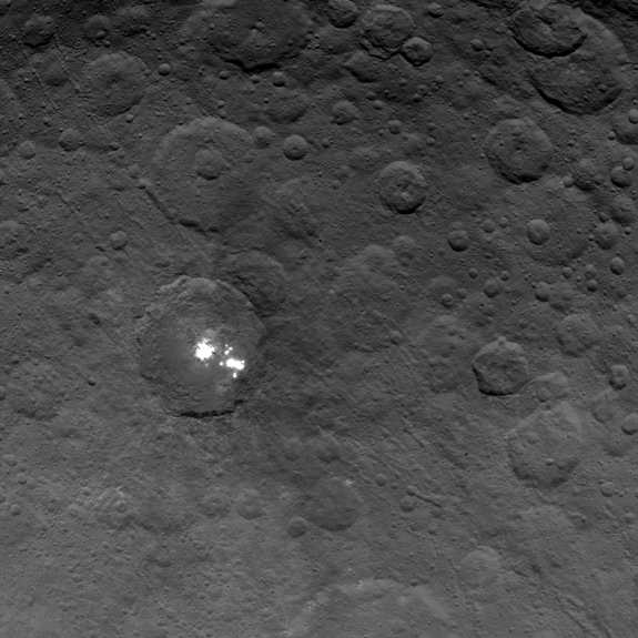 NASA's Dawn spacecraft obtained this image of the brightest spots on dwarf planet Ceres on June 6, 2015, from an altitude of 2,700 miles (4,400 kilometers). Image released June 10, 2015.