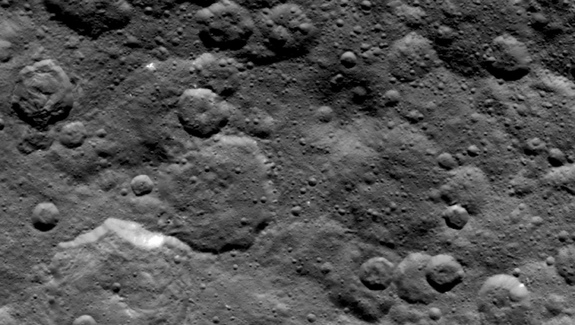 NASA's Dawn spacecraft obtained this image of craters in the northern hemisphere of dwarf planet Ceres on June 6, 2015, from an altitude of 2,700 miles (4,400 kilometers). Image released June 10, 2015.