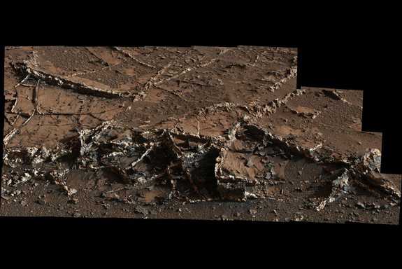 Mars looks pretty dry now, but mineral veins were deposited by fluids moving through rock.