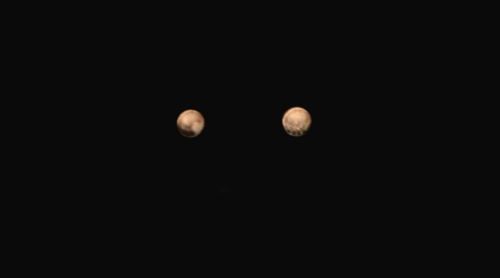 Mysterious Dark Spots on Pluto