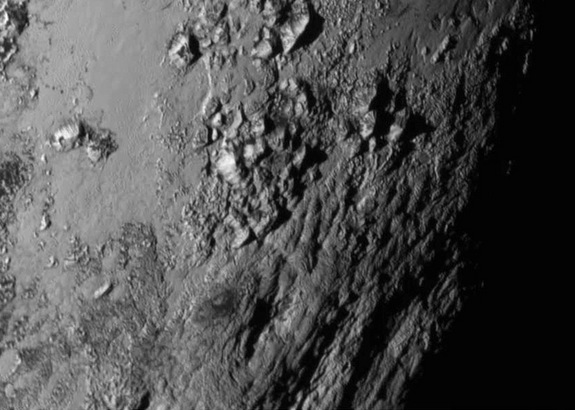 NASA's New Horizons spacecraft captured this image of Pluto's surface, which reveals ice mountains about 11,000 feet (3,500 meters) high, on July 14, 2015.