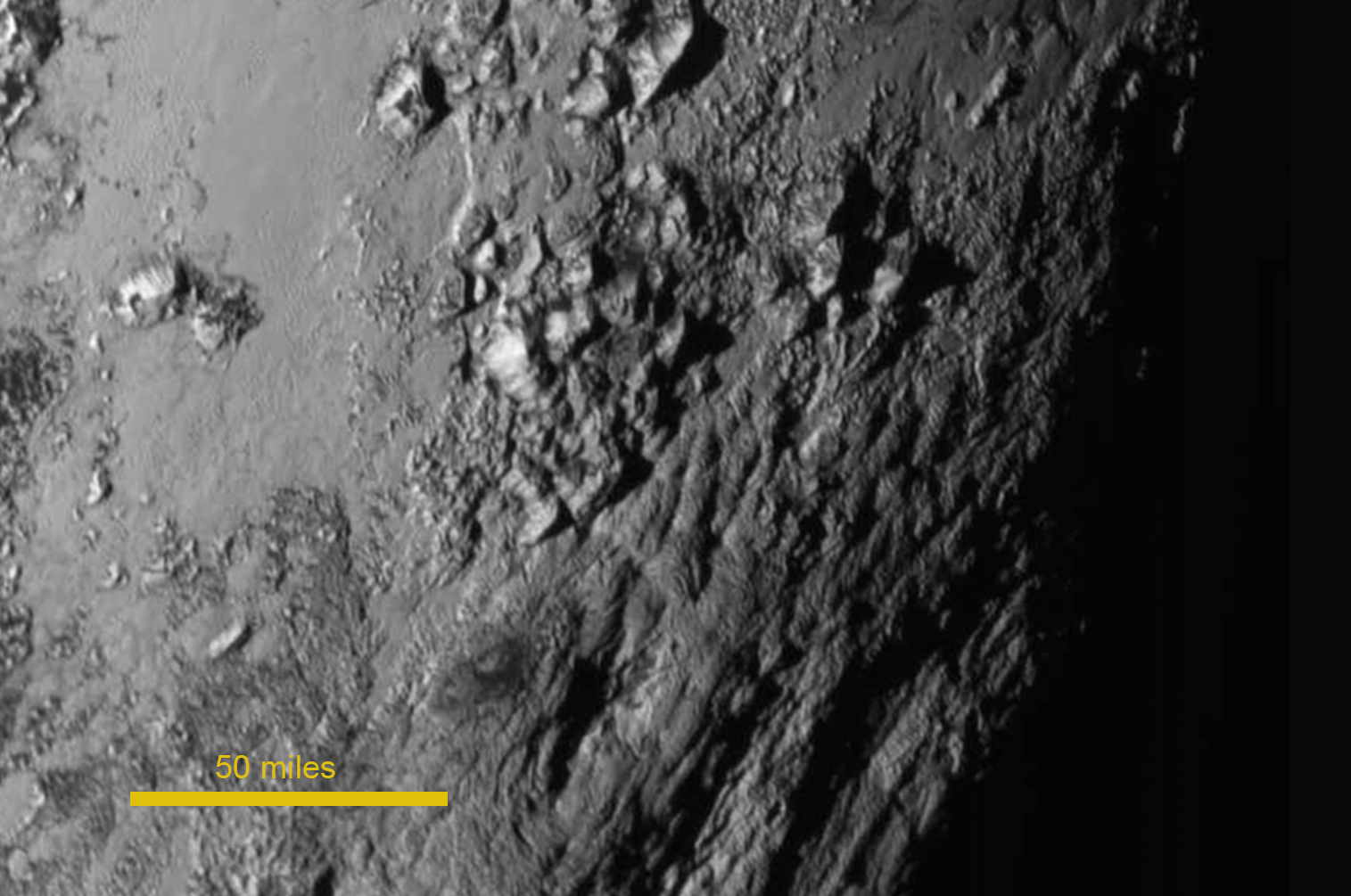 New Photos of Pluto and Moon Surprise, Puzzle Scientists