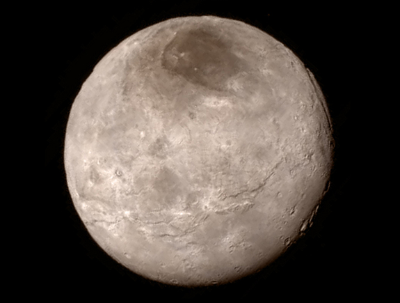 Canyons up to 6 miles (10 kilometers) deep are visible in this photo of Pluto's largest moon, Charon, captured by NASA's New Horizons probe on July 14, 2015 from a distance of 289,000 miles (466,000 kilometers).