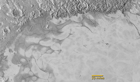 This photo of Pluto shows the northern region of Sputnik Planum, where flows of exotic ices have created swirl-shaped patterns much like glaciers on Earth, scientists say. NASA unveiled this image on July 24, 2015.