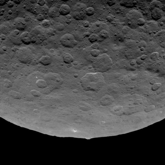"A 3-mile-high (5 kilometers) mountain dubbed ""The Pyramid"" juts from Ceres' limb in this photo by NASA's Dawn spacecraft."