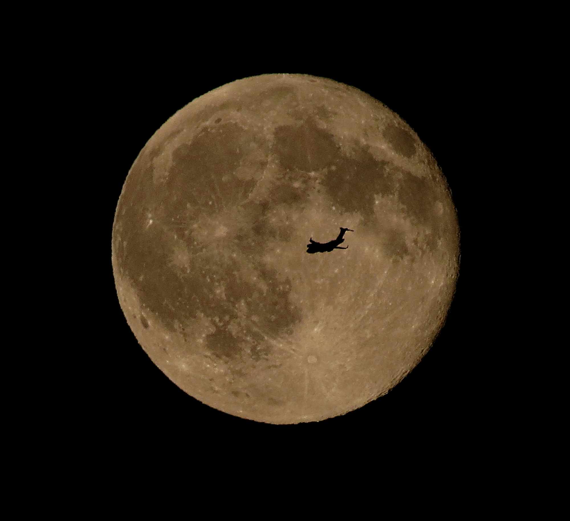 An airplane flies in front of the brilliant Blue Moon full moon of July 31, 2015 in this stunning photo captured by skywatcher Chris Jankowski of Erie, Pennsylvania on July 31, 2015.