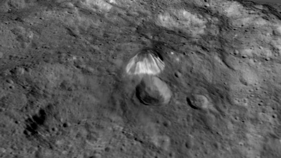 "Scientists have dubbed this brightly streaked, 4-mile-high (6.4 kilometers) mountain on the dwarf planet Ceres ""The Pyramid."""