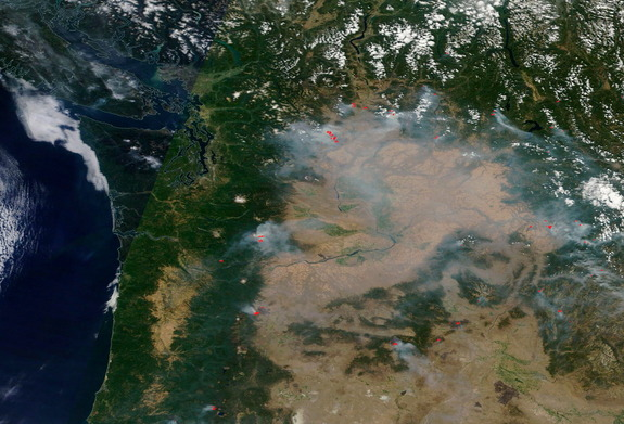 The Terra satellite captured this image over western and central Washington state on Aug. 17, 2015. Five major fires are burning in the north central part of the state. In addition, the Tower Fire in the northeastern corner of the state and the Cougar Creek Wildfire in the southwestern part of the state are adding to the smoke. The red pixels are heat signatures detected by the Moderate Resolution Imaging Spectroradiometer (MODIS) instrument onboard NASA's Aqua satellite.