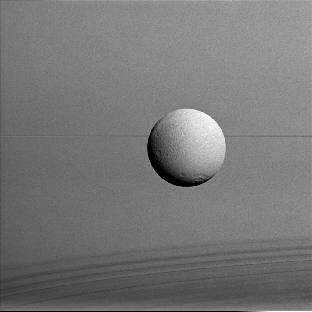 Dione with Saturn's Rings and Shadows