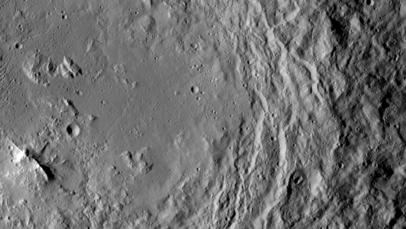 An image from NASA's Dawn spacecraft, taken on Aug. 19, 2015, shows a mountain ridge, near lower left, that lies in the center of Urvara crater on Ceres.