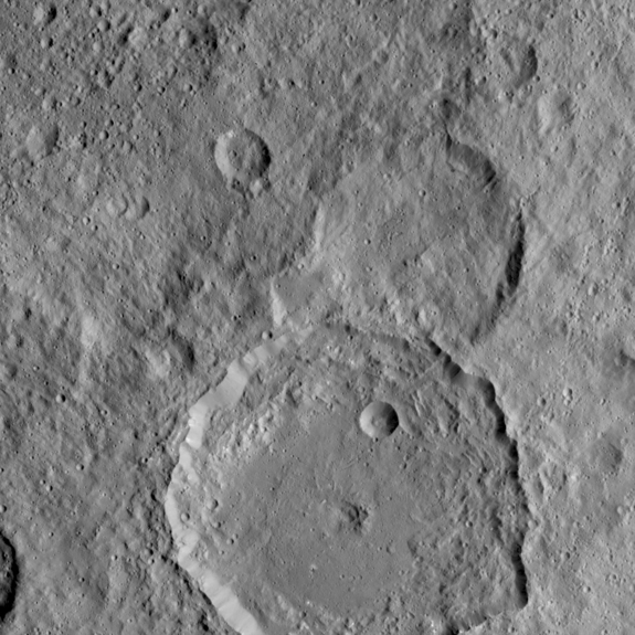 NASA's Dawn Spacecraft took this image of Gaue crater, the large crater on the bottom, on Ceres. Gaue is a Germanic goddess to whom offerings are made in harvesting rye. The image was taken on Aug. 19, 2015.