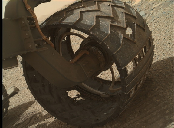 The wheel deal. Curiosity Mars rover is suffering from wheel wear, as seen in this image, taken August 16, 2015, Sol 1076. Designs are in the works for a new set of heftier wheels for the NASA Mars 2020 robot.